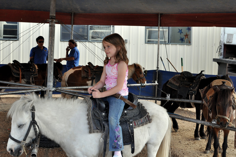 Ruby Short, 6, of Craig, takes a pony ride Tuesday during the Carson and Barnes Circus at the Moffat County Fairgrounds. Circus performances take place at 4:30 and 7:30 p.m. today at the Brent Romick Rodeo Arena, 501 Howelsen Parkway in Steamboat Springs.
