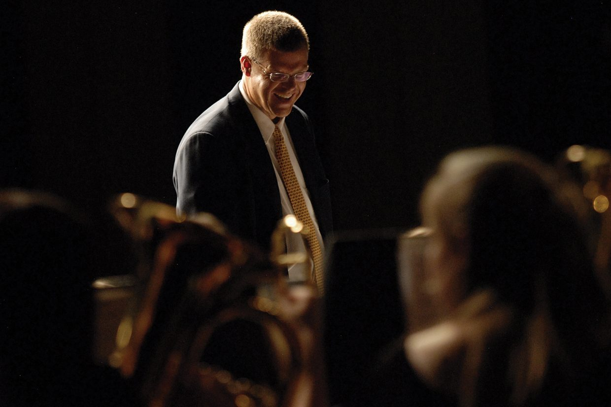 Moffat County High School band director John Bolton shares a light moment with the Craig Middle School eighth-grade band Thursday during the spring concert at the MCHS auditorium.