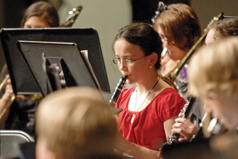 Craig Middle School seventh-grader Emily Womble performs Thursday during a concert in honor of CMS band teacher Craig Smith.