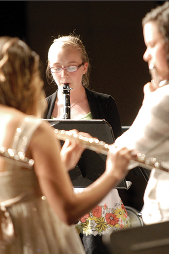 Craig Middle School seventh-grader Allie Dilldine, center, performs Thursday during a concert in honor of CMS band teacher Craig Smith.