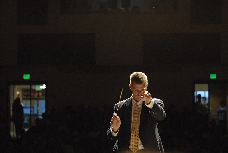 John Bolton, Moffat County High School band director, conducts the Craig Middle School eighth-grade band Thursday during the spring concert at the MCHS auditorium. Bolton was filling in for CMS band teacher Craig Smith, who died Sunday. He was 64. The spring concert was a memorial to Smith.