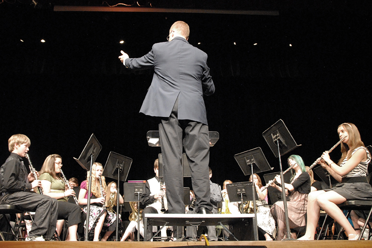 John Bolton, Moffat County High School band director, conducts the Craig Middle School sixth-grade band Thursday during the spring concert at the MCHS auditorium. Bolton filled in for CMS band teacher Craig Smith who died Sunday.
