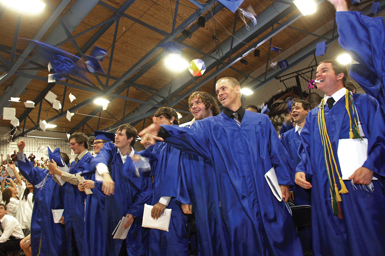Moffat County High School seniors throw their caps during a graduation ceremony Saturday at the MCHS gymnasium. The MCHS Class of 2010 had 169 graduates.