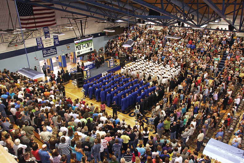 Visitors filled the Moffat County High School gymnasium Saturday for the 2010 graduation ceremony. The school set up a live video feed in the auditorium for overflow seating.