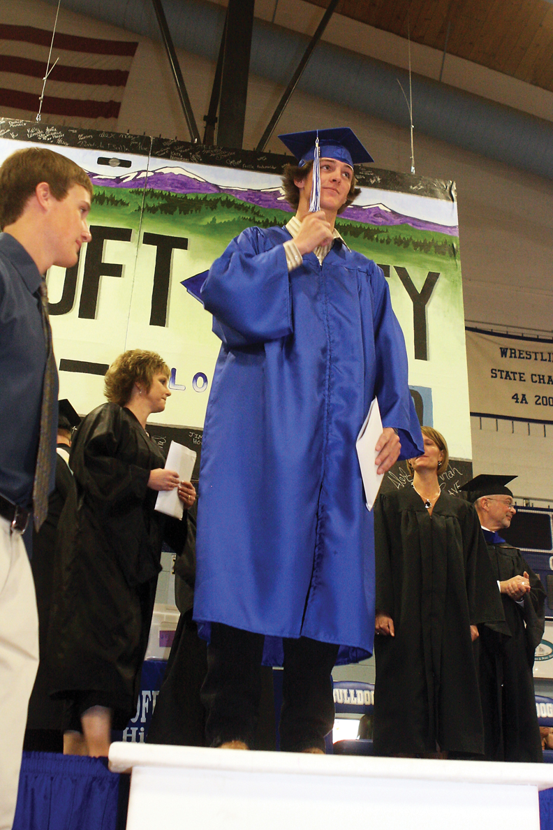 Nick Chew switches his tassel during the graduation ceremony Saturday at the Moffat County High School gymnasium. The Class of 2010 celebrated with firecrackers and silly string.