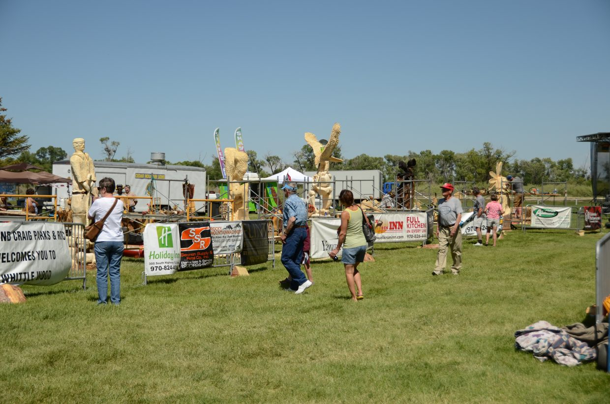 Residents walk amidst the carvings Friday at Loudy-Simpson Park