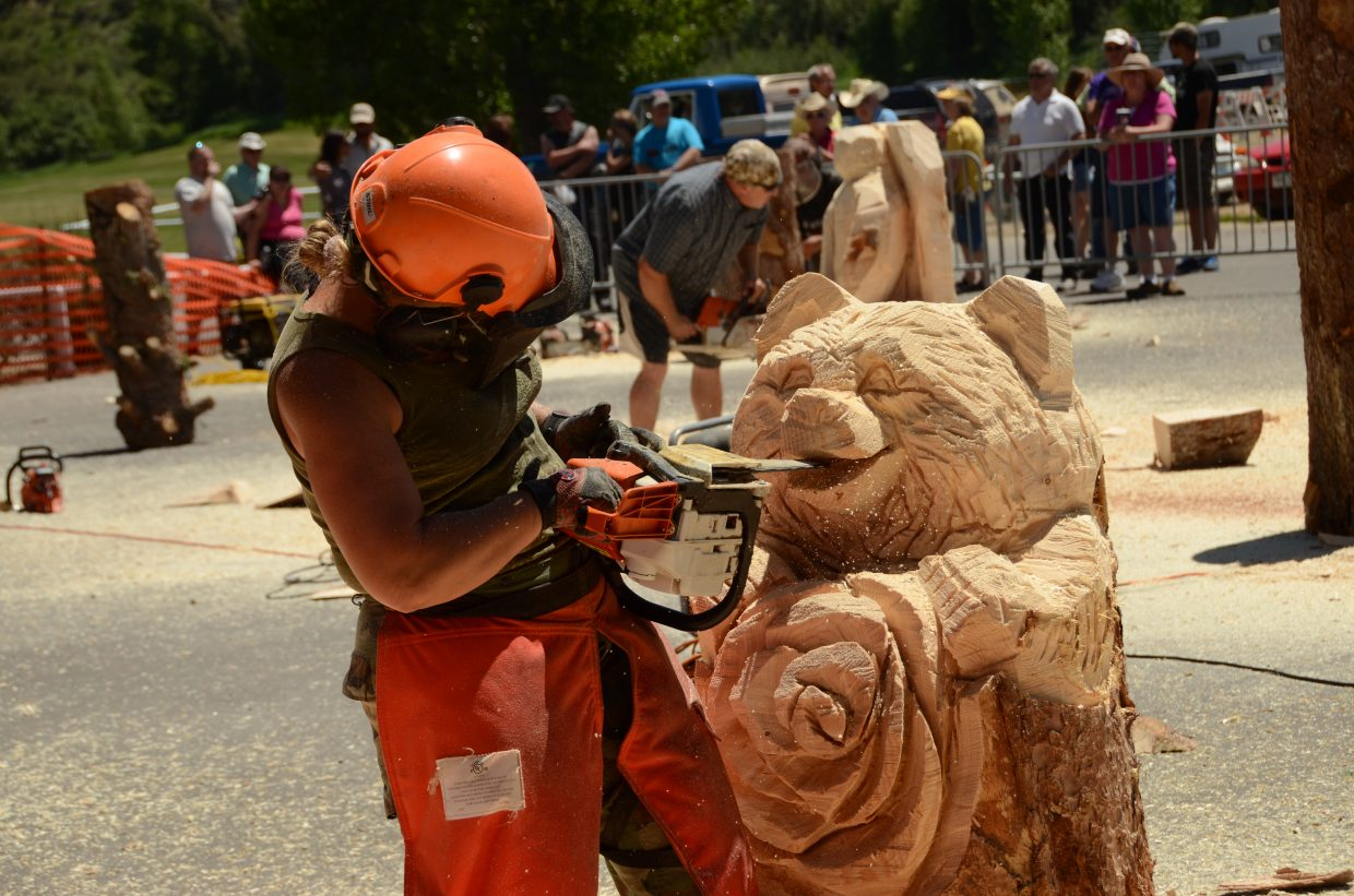 Faye Braaten widens the smile on her bear during the quick carve.