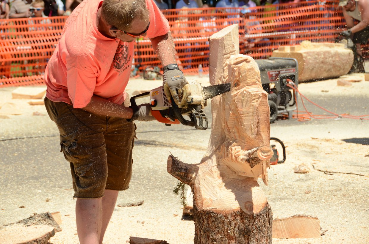 Nearing the midway point, many carvings began to take shape. Here, Ron Eye's owl perched on a branch began to show.