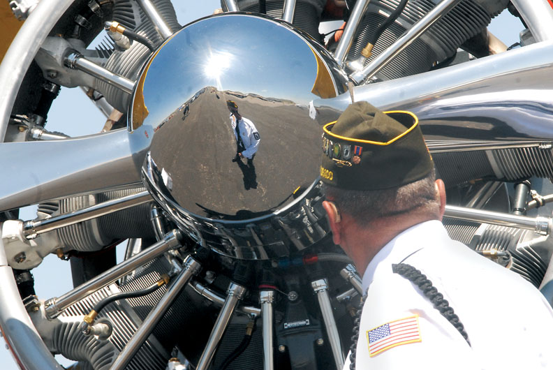 Larry Neu, of Craig, looks at the engine of a 1942 Boeing E75 Stearman on Saturday at the Craig Centennial AirFest.