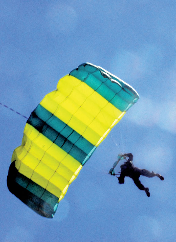 Joe Pete Lorusso floats down to the ground after parachuting out of a helicopter Saturday at the Craig Centennial AirFest. Lorusso, of Steamboat, jumped with Tom Corl.