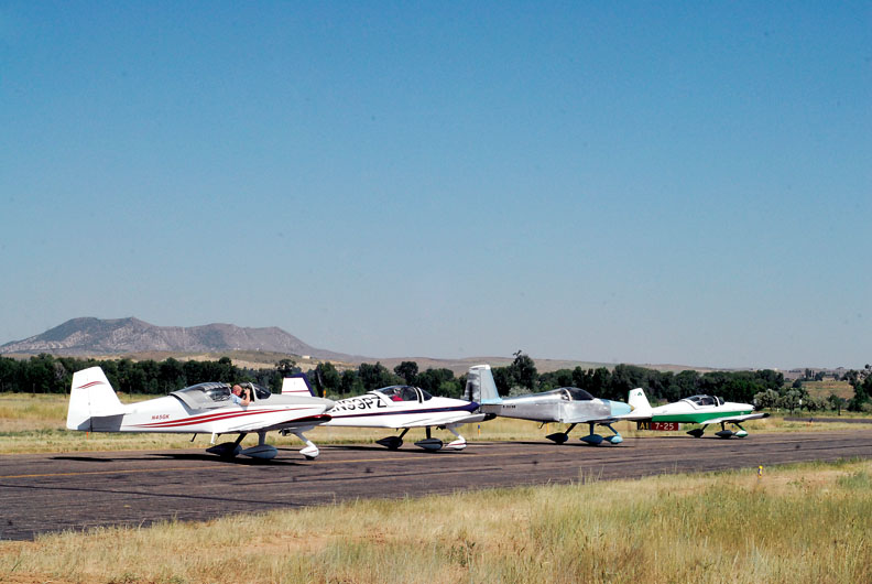 Planes line up at Craig/Moffat County Airport on Saturday on their way out of town. The planes spent the morning at the Craig Centennial AirFest.
