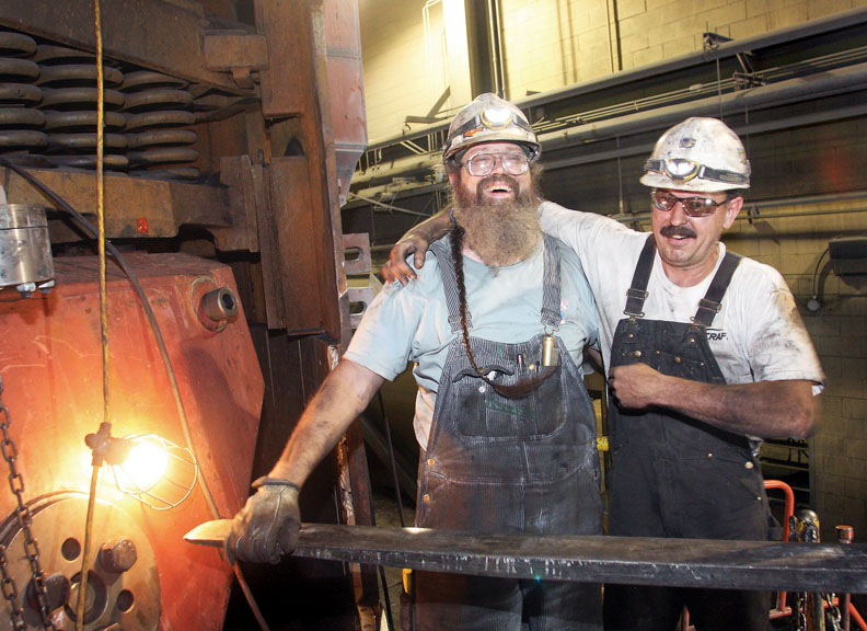 Mechanics Curtis Hejny, left, and Rick Mosher take a moment from working on a coal pulverizer for a quick laugh Thursday at Tri-State Generation & Transmission's Craig Station. The 1,304-megawatt coal-fired power plant employs about 300 residents full-time.