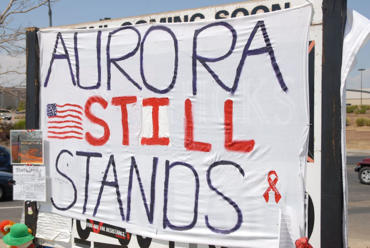 One of the many signs standing at a memorial honoring victims of a July 20 shooting at the Century Aurora 16 multiplex.