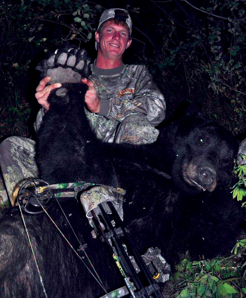 Rick Sanny with his prize bear, which took first place from the Colorado Bow Hunter Association in 2010.