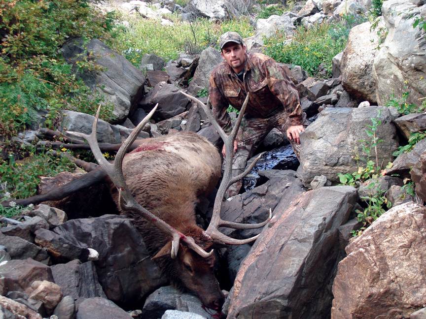 Olympic downhiller Craig Thrasher with his bull.