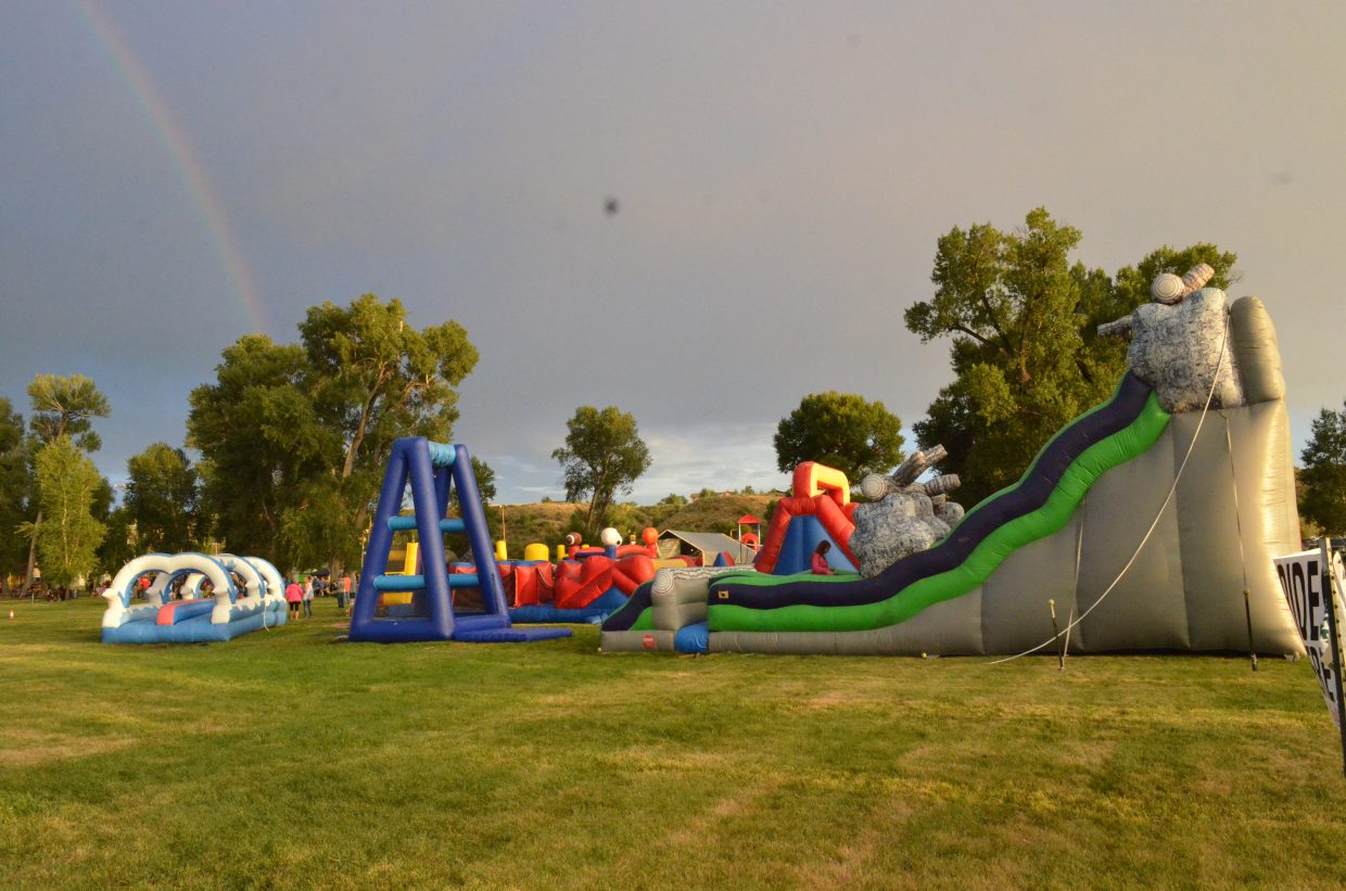 Bouncy houses catered to Craig's youth at the balloon festival.