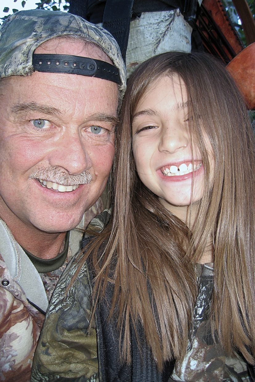 Gary Nichols, left, and daughter Tiana Nichols, 8, share a smile in a tree stand during the 2010 archery elk season in Moffat County. Although Tiana is too young to purchase an elk tag, she accompanies her father on nearly all of his hunts. Her first outing with her father was during bear season when she was four days old.