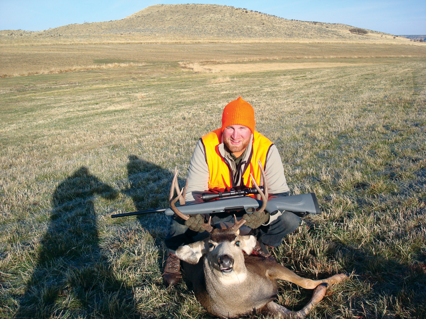 Craig resident Luke Schafer poses with a 4-by-4 buck, which he scored in the Marapos Creek area in western Moffat County.