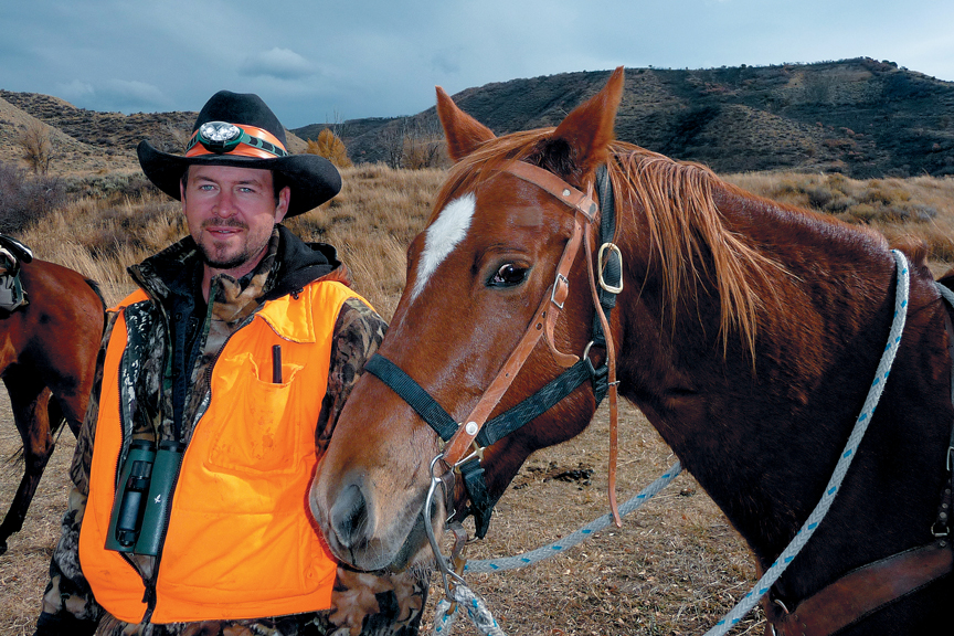 Tony Lawton, of Grand Junction, poses last hunting season before heading out for a hunt on Indian Run in Northwest Colorado.