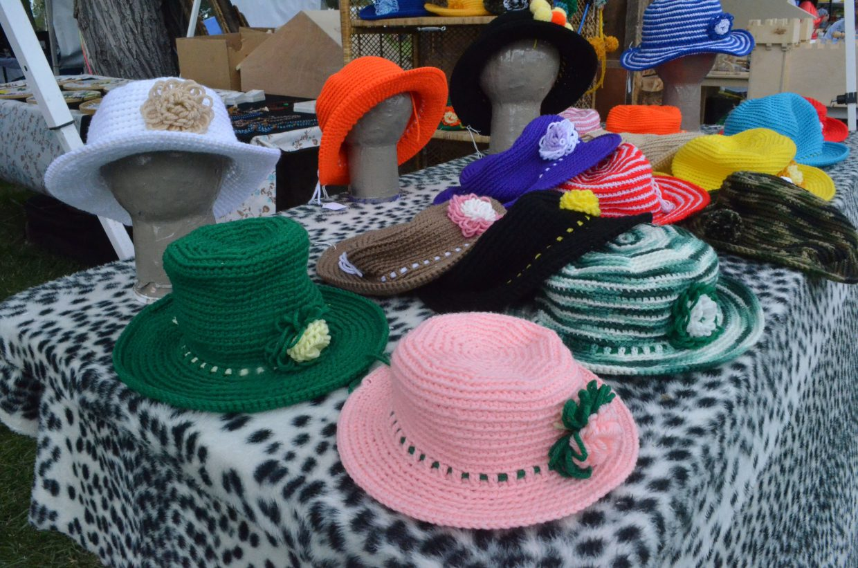 A variety of specialty knitted hats are on display among vendors' booths at Whittle the Wood Rendezvous.