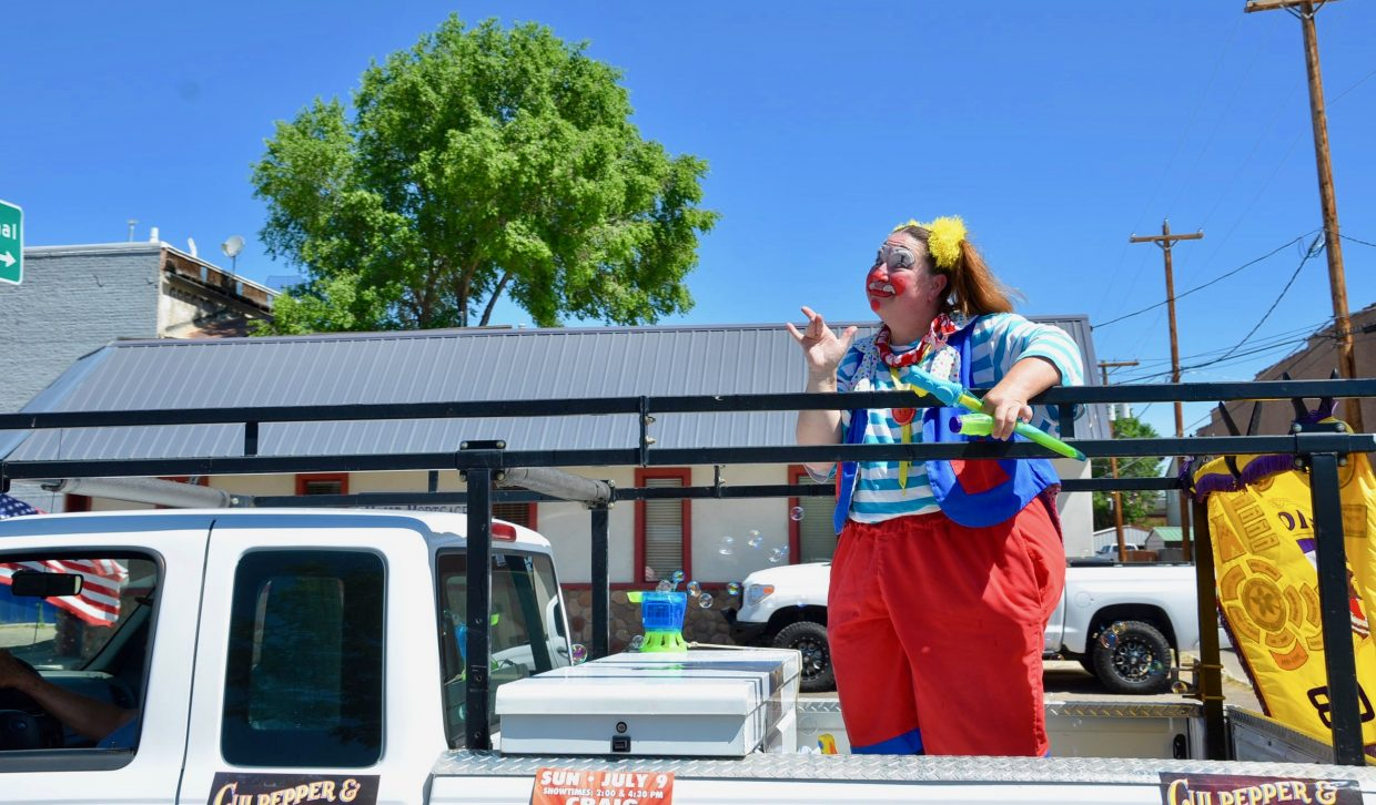 A clown from the Culpepper and Merriweather circus was riling up the crowd.