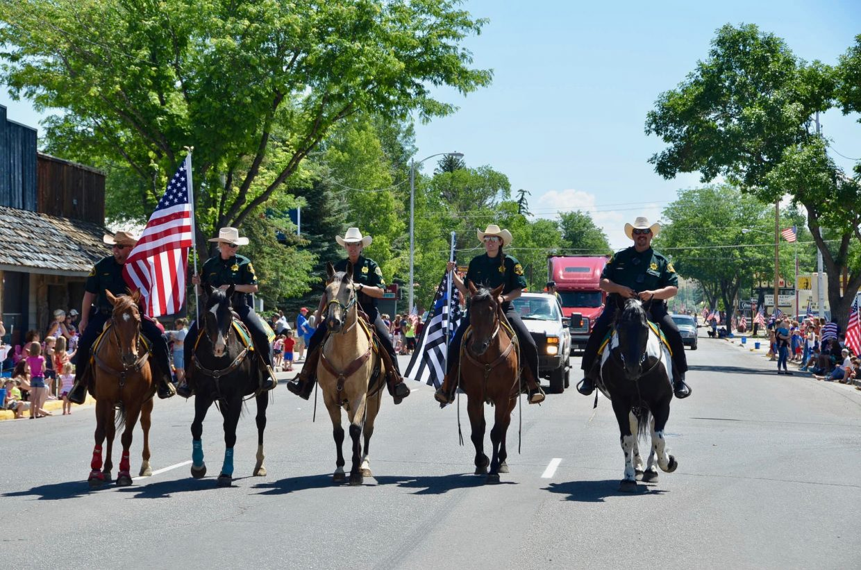 Members of the sheriff's office ride proud during the Fourth of July parade.