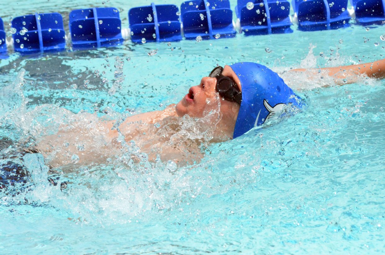Travis LeFevre, 10, swims the backstroke during Craig Sea Sharks ABC Meet June 17 and 18 at the Craig Pool Complex.
