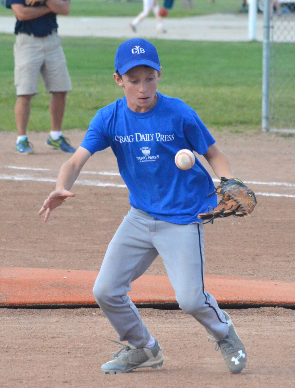 Ryan Booker gets after a live ball during the championship game for Craig Parks and Recreation's youth baseball season.