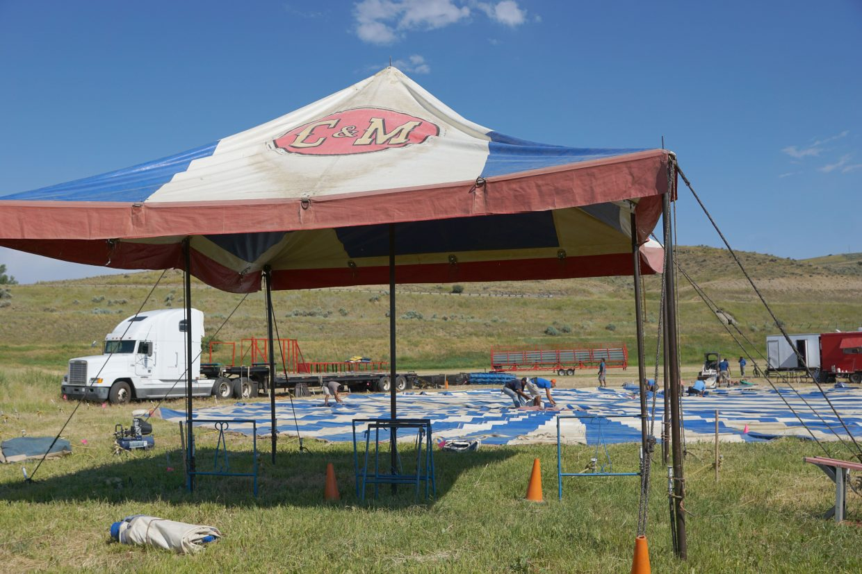 A crew of about 10 people rollout the Culpepper & Merriweather Circus big top. in Craig Sunday