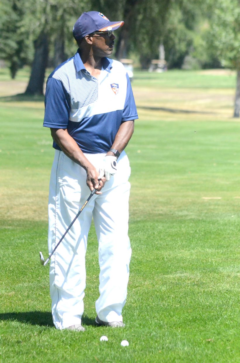 Former Denver Bronco Wade Manning gets ready to chip from the rough near the ninth green at Yampa Valley Golf Course for the Rick Upchurch Drive 4 Life Cancer Golf Tournament. Multiple former Broncos attended the event, including Manning, Upchurch, Ron Egloff, Le-Lo Lang and Dave Studdard, among others.