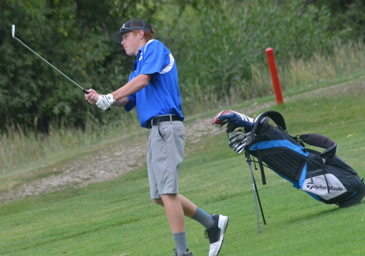 Moffat County High School's Torin Reed takes a short chip from the eighth fairway at Yampa Valley Golf Course during Wednesday's Bulldog Invitational.