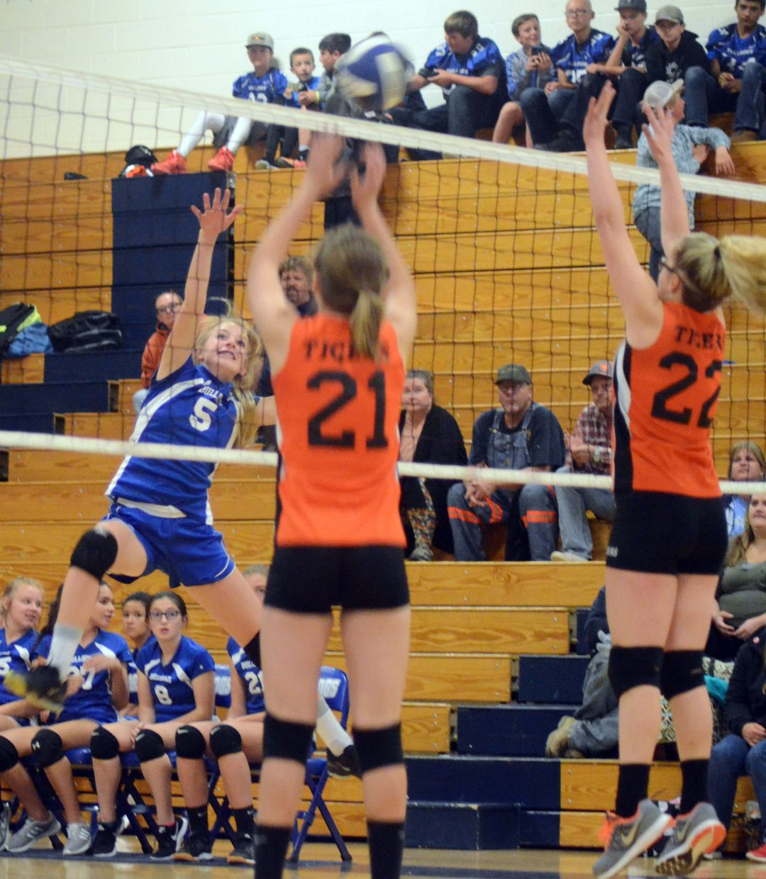 Craig Middle School's Halle Hamilton takes a wild shot during a Thursday volleyball game against Hayden.