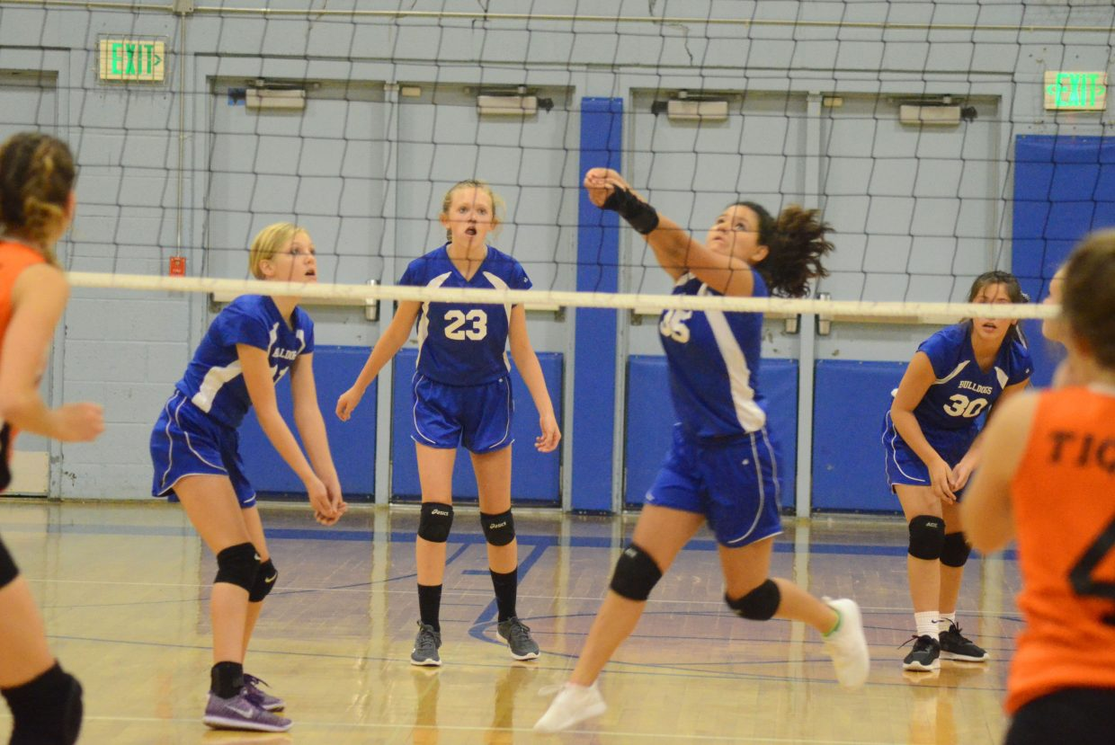 Craig Middle School's Shay Wait swoops in with the bump during a Thursday volleyball game against Hayden.