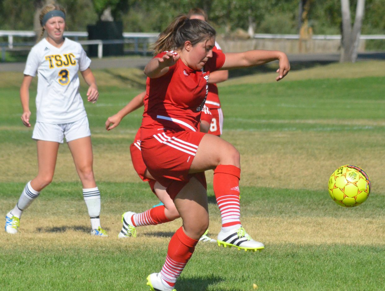 Colorado Northwestern Community College women's soccer player Ciara Wilson improvises a crane kick at midfield against Trinidad State Junior College. CNCC women fell 17-0 to the Trojans.