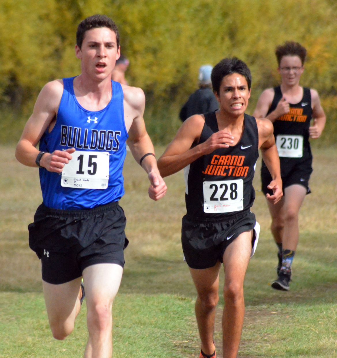 Moffat County High School cross country's Grant Wade guts it out against Grand Junction opponents during the Bulldog Invitational Saturday at Loudy-Simpson Park.