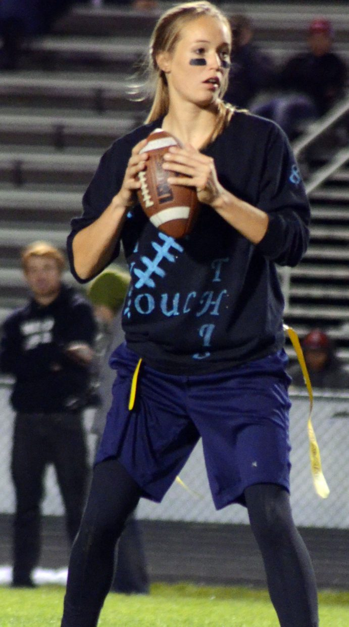 Madie Weber of Can't Touch This looks for an open receiver during the Powder Puff Football tournament Wednesday night at Moffat County High School.