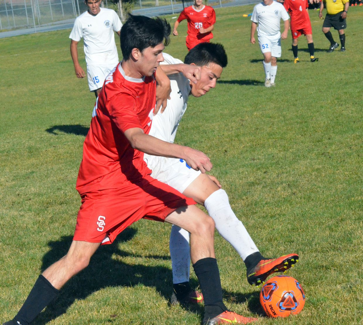 Moffat County High School's Josh Pando and Steamboat Springs' Jake Berry fight it out for the ball near the sideline during Thursday's soccer game in Craig. Steamboat won 3-2 in overtime.