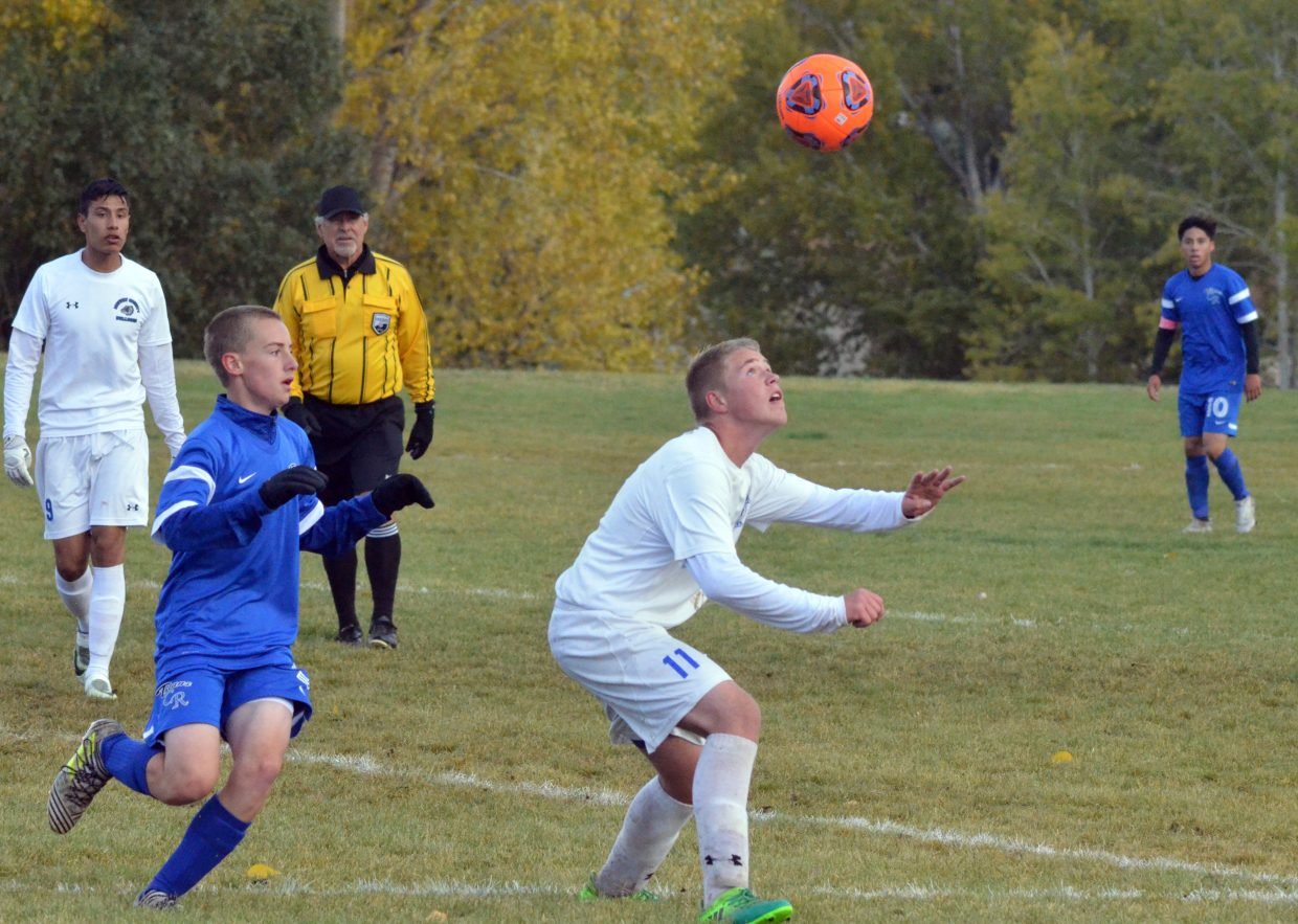 Moffat County High School's Christopher Cox positions himself for a header during a Monday game against Coal Ridge.