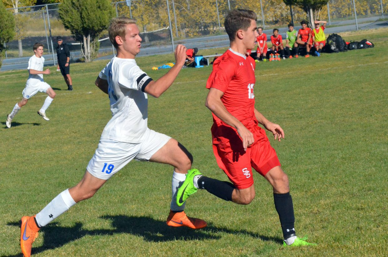 Moffat County High School senior Wyatt Nielsen stays in step with Steamboat opponents.