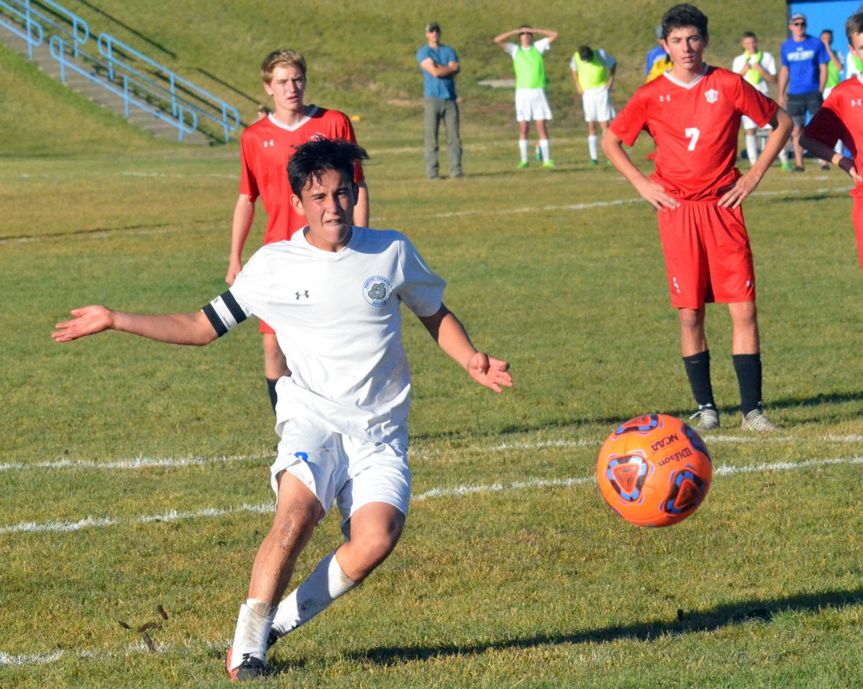 Moffat County High School senior Juan Loya lets loose a penalty kick against Steamboat. Loya scored both Bulldog goals in a 3-2 defeat to the Sailors.