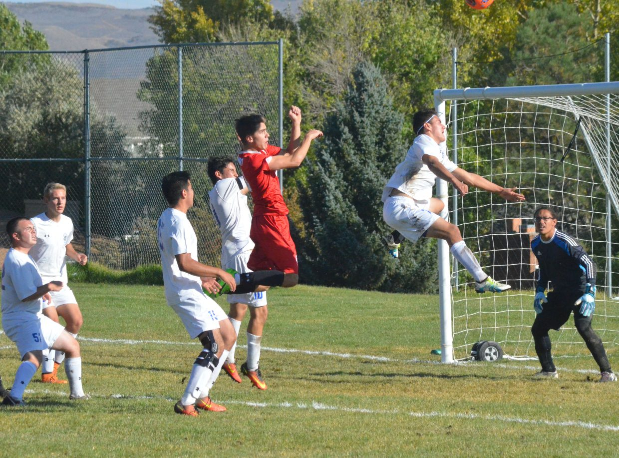 Moffat County High School's Victor Silva throws himself in front of a Steamboat corner kick during Thursday's soccer game in Craig.