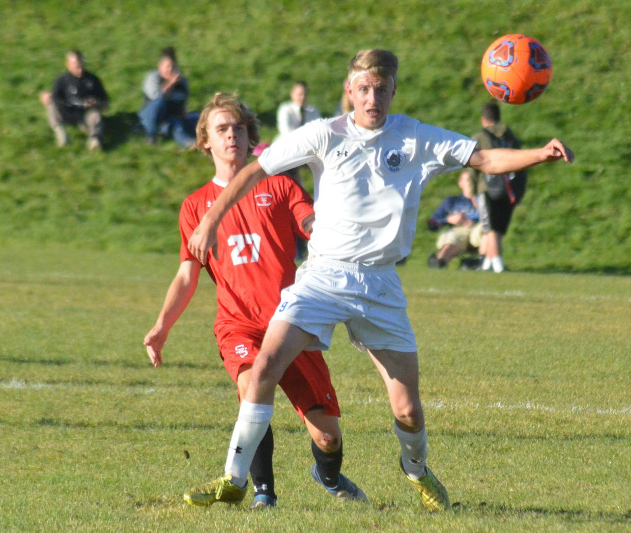 Moffat County High School senior Tristen Walls knocks away the ball from the Steamboat Springs opposition.