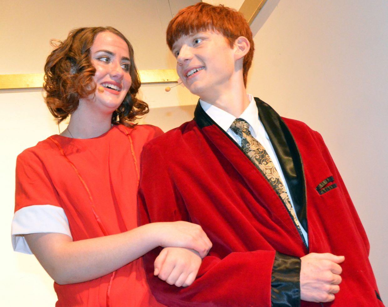 Annie (Courtney Smith) and Oliver Warbucks (Aaron Hill) get to know each other in