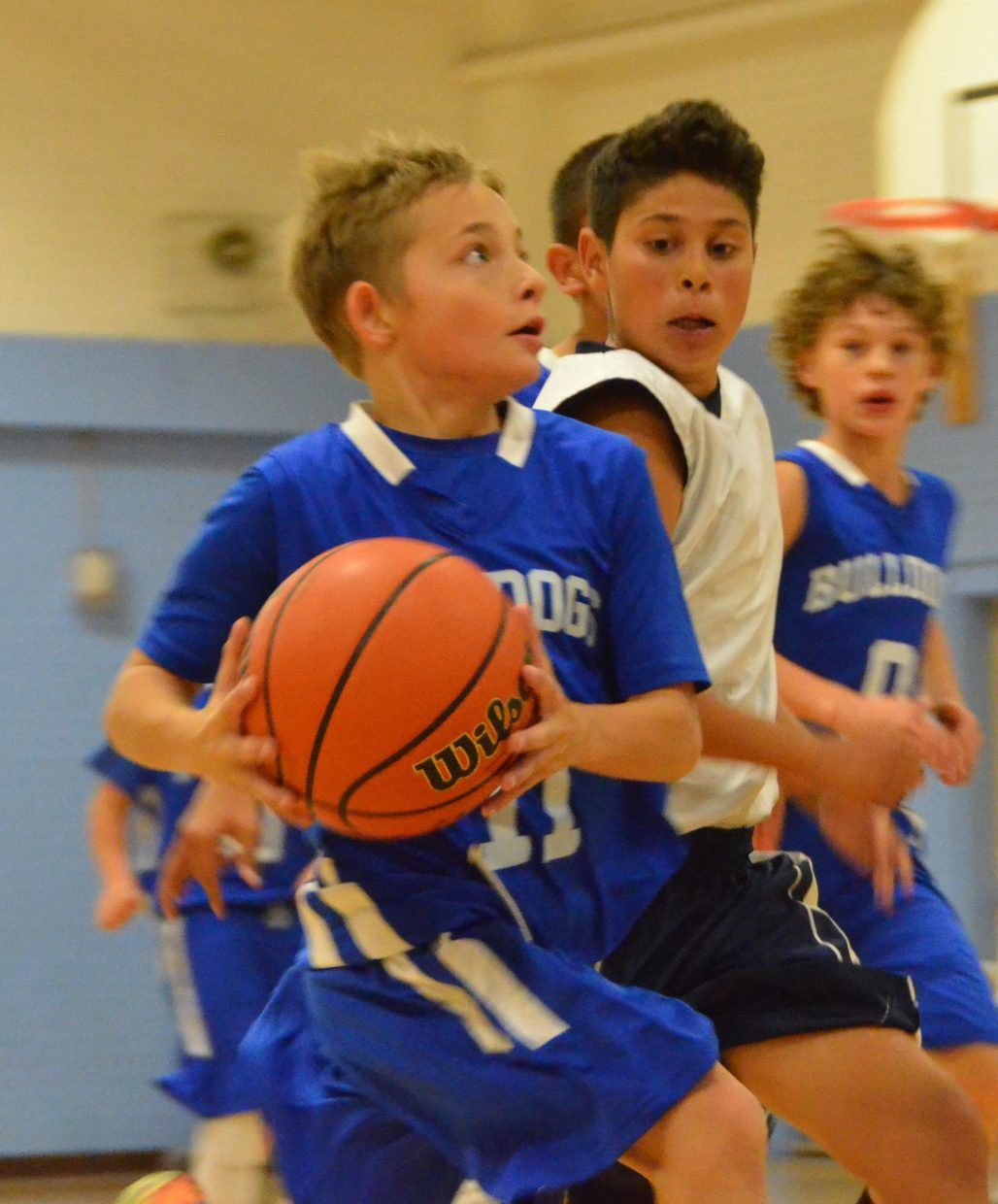 Craig Middle School's Easton Briggs gets on a fastbreak during Saturday's boys basketball tournament.