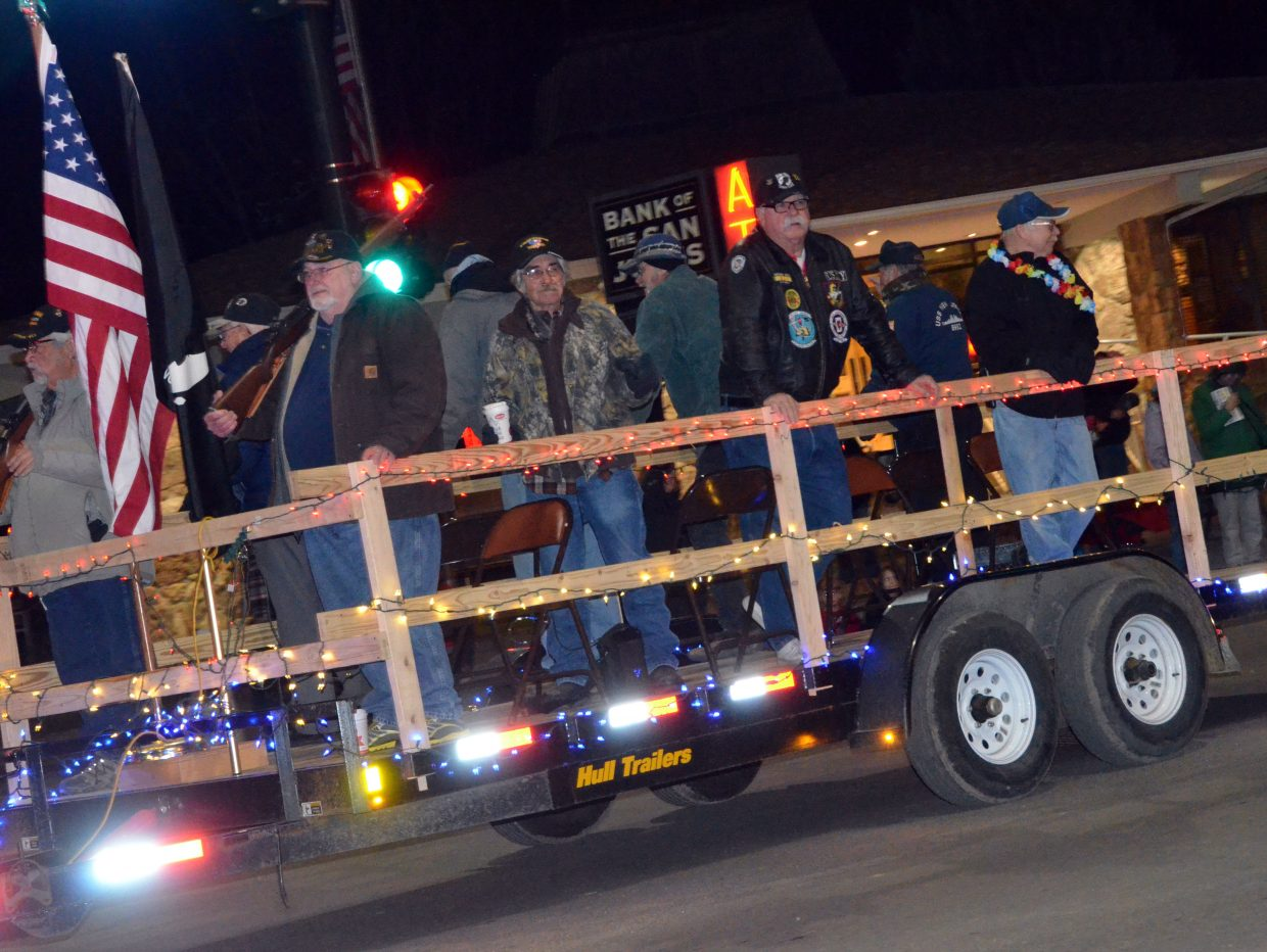Craig veterans greet the crowd during Saturday's Parade of Lights.