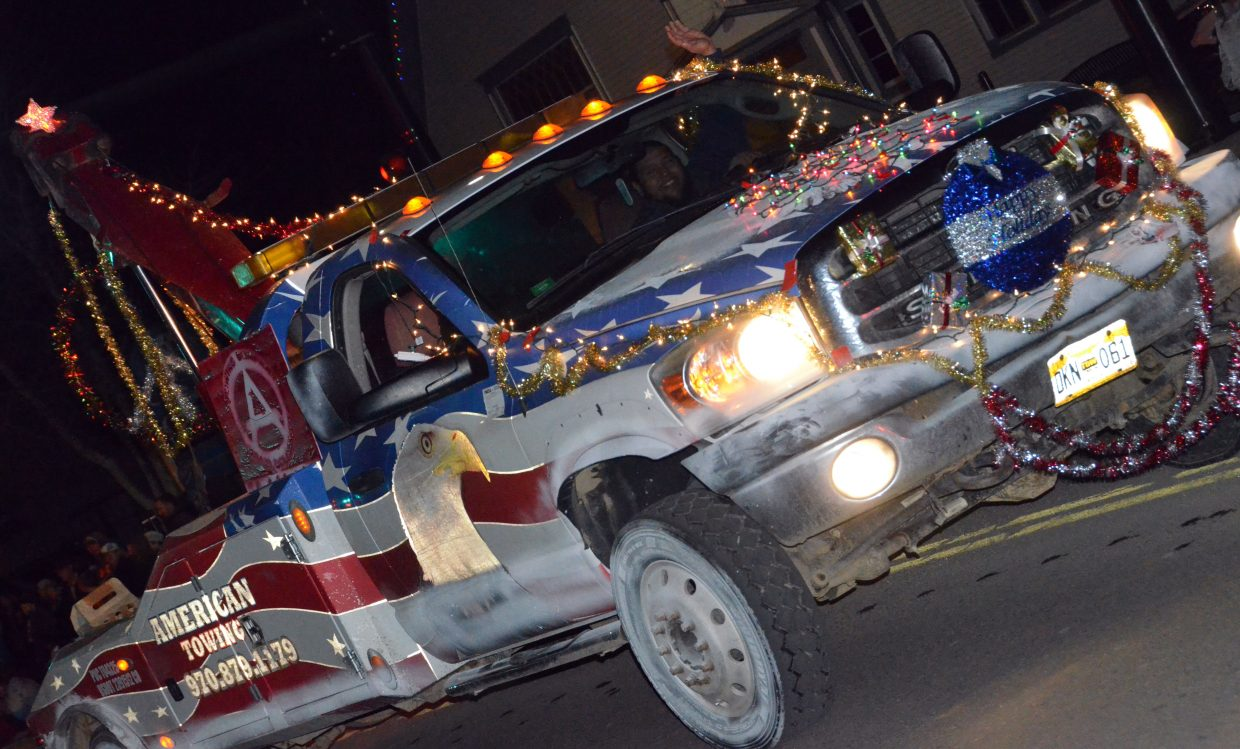 A tow truck is decked out with holiday cheer during the Parade of Lights.