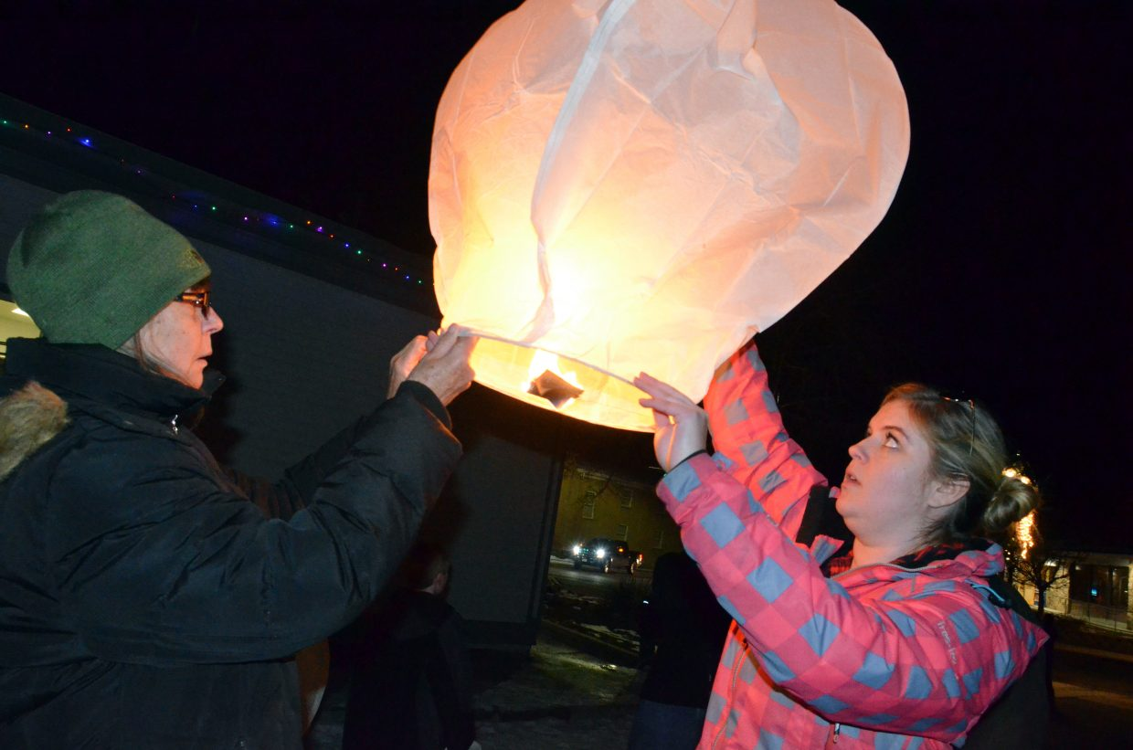 Debbie Voborsky, left and Kendall Yeager allow a lantern to fill with heat before allowing it to lift off during Wednesday's Celebration of Light, hosted by Northwest Colorado Health and Grant Mortuary. Lanterns represent the lives of departed loved ones, and Voborsky said she let off her lantern to honor a number of late family members.