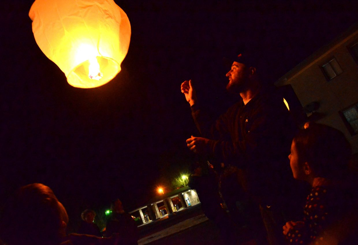 Jon Culver lets loose a lantern during Wednesday's Celebration of Light, hosted by Northwest Colorado Health and Grant Mortuary. Culver said he was honoring the memory of his mother with the lantern.