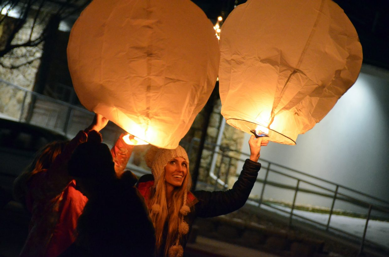 Brooke Cape takes a moment to think of loved ones before releasing a lantern during Wednesday's Celebration of Light.