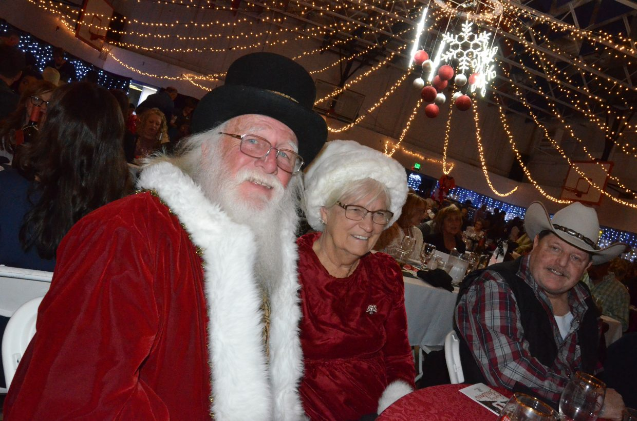Santa and Mrs. Claus enjoy the sights and sounds of Cowboy Christmas Saturday at Boys & Girls Club of Craig. Santa — otherwise known as George Kidder — was awarded Volunteer of the Year for his work within the community. He also announced this will be the final Christmas for the couple in Craig as they prepare to move to Florida.